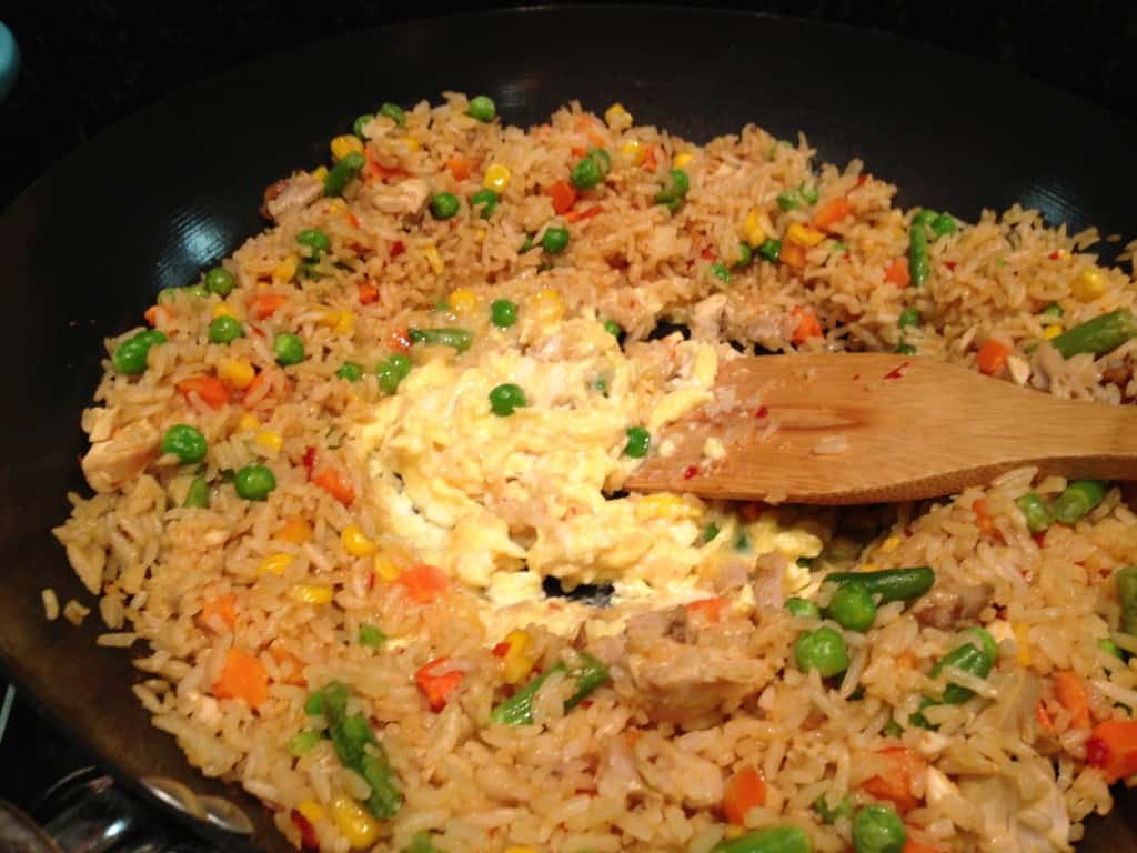 Adding egg to the fried rice