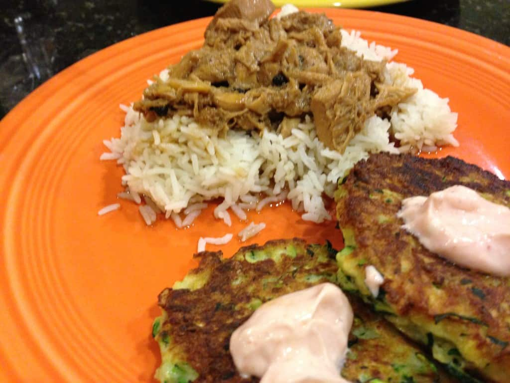 Chicken adobo with a side of zucchini fritters.
