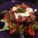 Steak salad with roasted peppers and green goddess dressing.