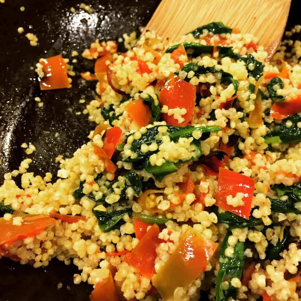 Cooked millet with spinach and roasted peppers